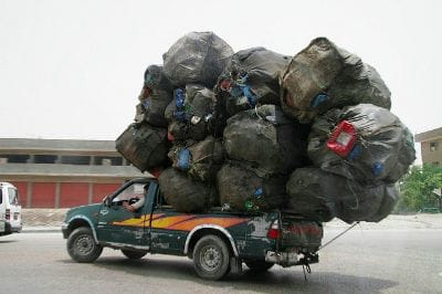 Truck hauling WAY too much garbage