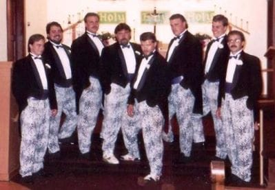 Men in suits at a wedding wearing zubaz