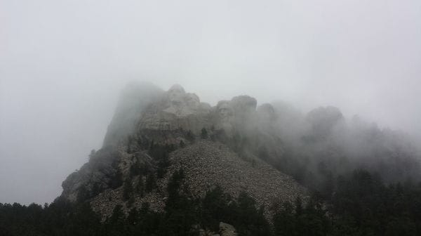 Mount Rushmore with the fog lifting