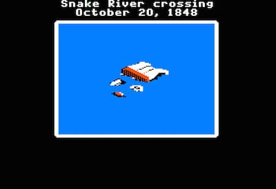 Screenshot of wagon tipped over in a river