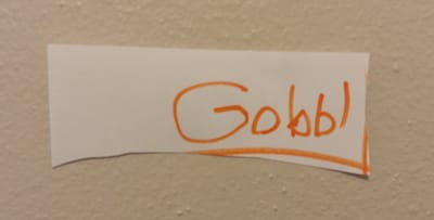 "Piece of paper with ""Gobble"" written on it, spelled G-o-b-b-l"