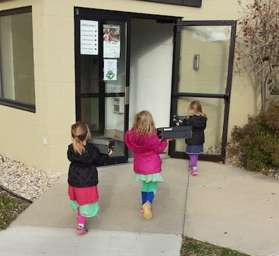 Our three girls walking to the drop-off for Samaritan's Purse
