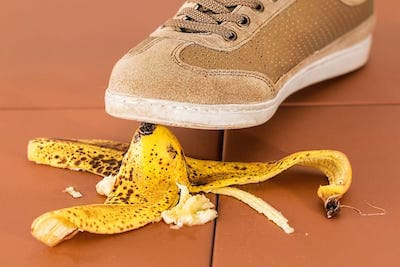 Foot about to step on a banana peel