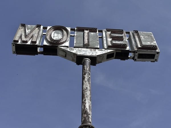 "Rusted ""Motel"" sign"