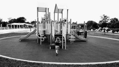Girl running toward playground