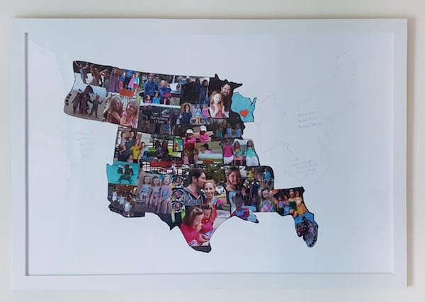 Posterboard with US States outlines. States we've visited are filled in with pictures from that portion of our trip