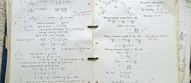 Math notebook with complicated formulas