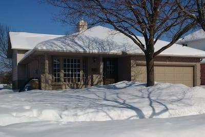 Picture of nice looking suburban home covered in snow