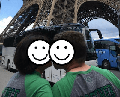 Dave and his wife kissing in front of the Eifel tower