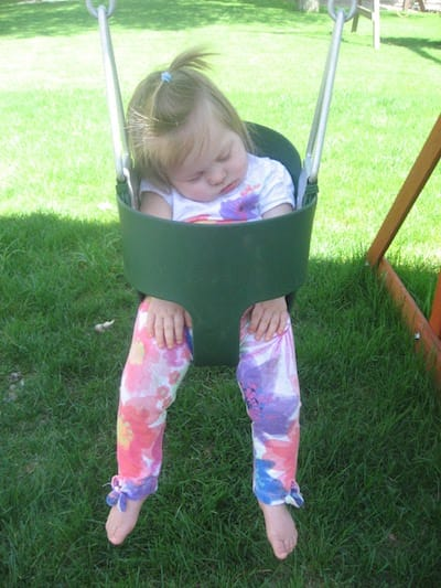 One of our girls asleep in a baby swing