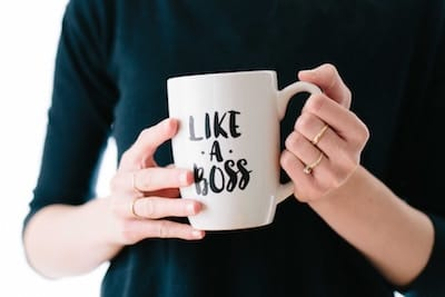 "Woman holding mug with words ""Like a Boss"" on it"