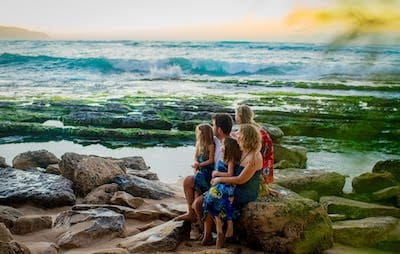 Our family on a beach in Hawaii, looking out into the distance