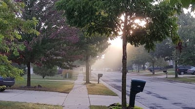 Beautiful suburban street with sunrise