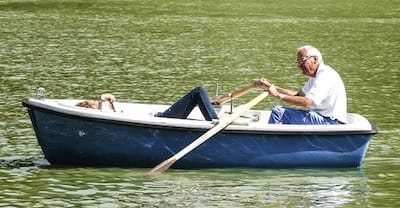 Elderly man rowing boat