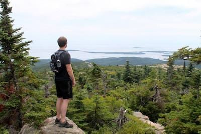 Jared looking out over the terrain in Bar Harbor, Maine