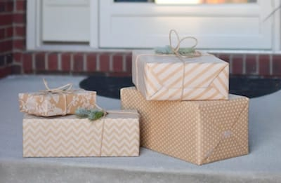Gift-wrapped packages on a doorstep