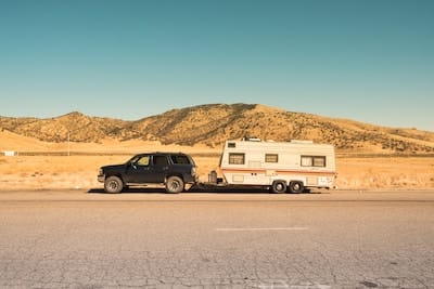 Pickup truck and camping trailer on the side of the road