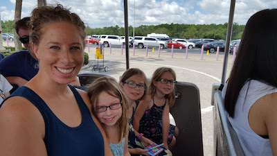 Jaime and the girls in the parking lot tram at Disney World