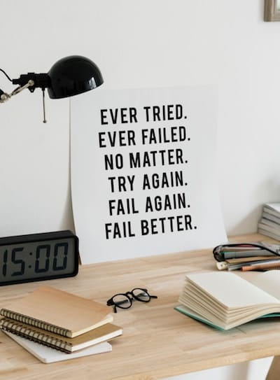 "Sign on desk with words ""Ever Tried. Ever Failed. No Matter. Try Again. Fail Again. Fail Better"""