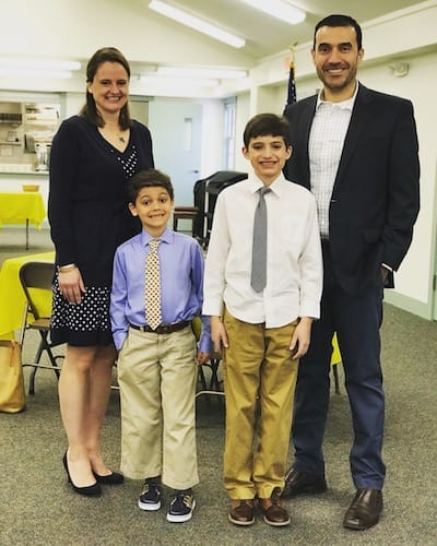 Laurie, her husband, and their sons in dress clothes
