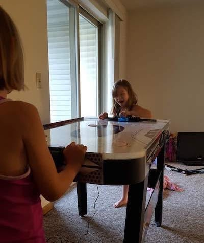 Girls playing on air hockey table