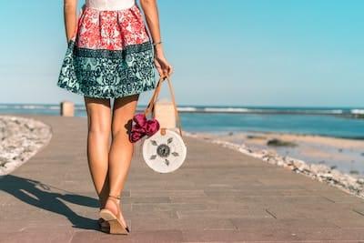 Girl walking on boardwalk at beach