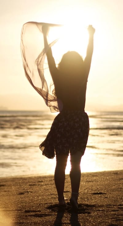 Woman celebrating on beach