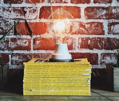 Lamp on top of a stack of 'National Geographic' magazines