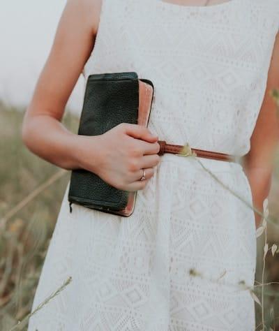 Woman holding bible