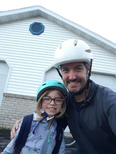 Getting ready to bike with my oldest daughter