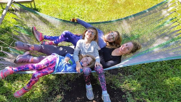 Jaime and the girls cuddling in a hammock